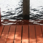 Water over the dock step.  Hasn't been like this high since we were hit by a freak early tropical storm in 2006.